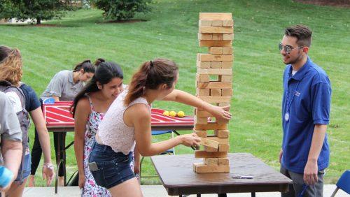 Rivier students playing jenga